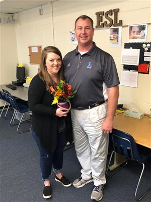 Mr. Reed, principal of AJHS, poses with Teacher of the Year, Rebecca Vining